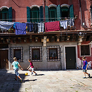 Children play soccer in a plaza in the Dorsoduro neighborhood on a late summer afternoon.