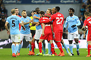 Yaya Toure of Manchester City and Adam Lallana of Liverpool are pulled apart after an argument. Capital One Cup Final, Liverpool v Manchester City at Wembley stadium in London, England on Sunday 28th Feb 2016. pic by Chris Stading, Andrew Orchard sports photography.