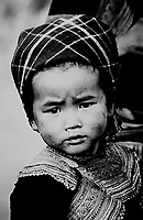 A young flower hmong minority girl with an emotional gaze in Northern Vietnam.
