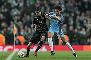 Mikael Lustig (Celtic) holds off Leroy Sane (Manchester City) during the Champions League match between Manchester City and Celtic at the Etihad Stadium, Manchester, England on 6 December 2016. Photo by Mark P Doherty.