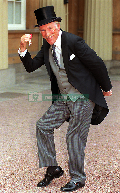 File photo dated 22/07/98 of Sir Bruce Forsyth with his OBE, as the veteran entertainer has died aged 89.