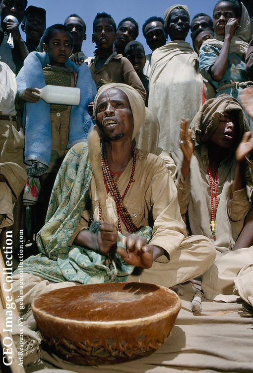 Moslem pilgrims chant prayers to the beat of a drum.