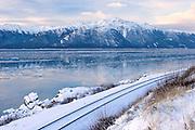 USA, Alaska, Chugach National Forest, Turnagain Arm, Seward Highway, Sunrise view of the Alaska Railroads tracks along the Turnagain Arm in winter just south of Anchorage.