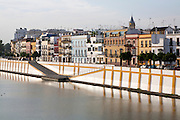 Historic houses on Calle Betis in the Triana district on the banks of the Guadalquivir river, Seville, Spain