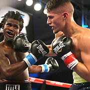 ORLANDO, FL - OCTOBER 04: Jovan Perez (R) punches Berthin Rousseau with a right hook during a professional boxing match at the Bahía Shriners Auditorium & Events Center on October 4, 2014 in Orlando, Florida. Perez would later win the fight.  (Photo by Alex Menendez/Getty Images) *** Local Caption *** Felix Verdejo; Sergio Villanueva
