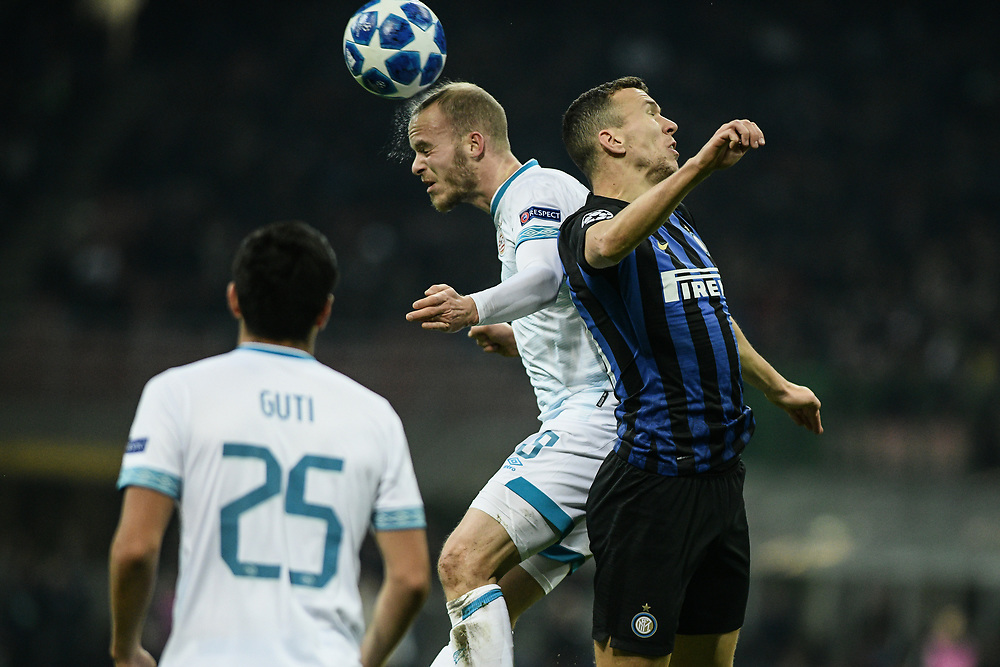 Midfielder Jorrit Hendrix(PSV Eindhoven) and Midfielder Ivan Perisic (Inter) go for a header during the UEFA Champions League football match, Inter Milan vs PSV Eindhoven at San Siro Meazza Stadium in Milan, Italy on 11 December 2018