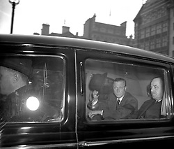 File photo dated 13/2/1952 of the Duke of Windsor, wearing a black arm band, raises his hat to bystanders who greeted him as he arrived by car at Marlborough House, London, home of his mother Queen Mary where he had arrived in London to attend the funeral of his brother, King George VI. Almost 70 years ago an abdicated king returned from the US for a royal funeral, while his American wife was absent. Issue date: Thursday April 15, 2021.