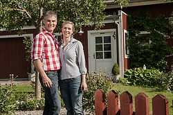 Happy couple in front of home house