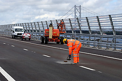 Final works are carried out on the Queensferry Crossing, the new road bridge over the Firth of Forth, South Queensferry, ahead of the official opening by Queen Elizabeth II on September 4, 2017.
