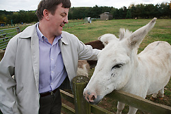 Man with learning disability on trip to farm with donkey
