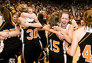 NEWS&GUIDE PHOTO / PRICE CHAMBERS.The Jackson Hole High School girls basketball team celebrates their 3A State Championship in Casper on Saturday night. Their 49-42 victory over Powell marks the fourth year in a row the Broncs have earned the state title.