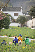 Artist painting the view of Xidi village with tourists watching behind him, UNESCO World heritage, Anhui province, China