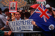 On the eve of the historical Handover of sovereignty of Hong Kong from Britain to China, pro-UK Chinese gather in the rain outside the official residence of outgoing Governor, Chris Patten, on 30th June 1997, in Hong Kong, China. (Photo by Richard Baker / In Pictures via Getty Images)