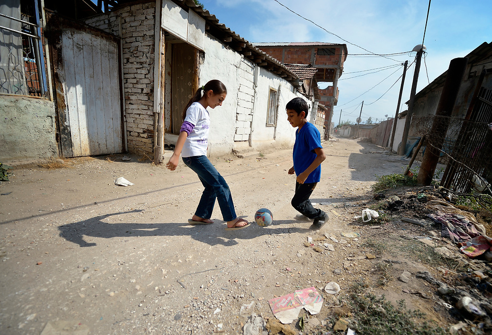 Two Roma children play football (soccer) in Suto Orizari, the Macedonian municipality that is Europe's largest Roma settlement.