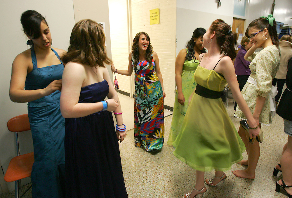 Quincy, MA 04/08/2010<br /> Nichol Driscoll (center) shares a laugh with other models backstage before the start of Thursday's Student Fashion Show held at Quincy High School.