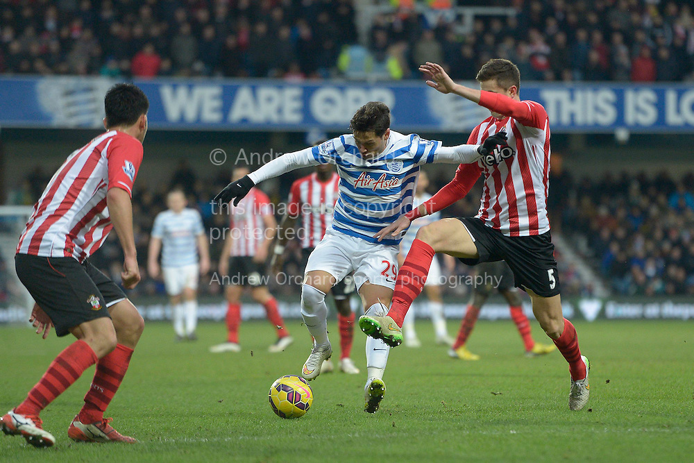 Mauro Zarate of QPR being intercepted by Florin Gardos of Southampton. Barclays Premier league match, Queens Park Rangers v Southampton at Loftus Road in London on Saturday 7th Feb 2015. pic by John Patrick Fletcher, Andrew Orchard sports photography.