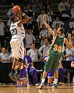 Kansas State guard Cartier Martin (20) puts up a three point shot over Cleveland State's Kevin Francis (30) in the first half at Bramlage Coliseum in Manhattan, Kansas, December 5, 2006.  K-State beat the Vikings 93-60.<br />