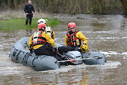 © Licensed to London News Pictures. 29/03/2016. Surrey, UK. Emergency services searching the River Wey in Guildford, Surrey for a man who disappeared after a kayak capsized as Storm Katie hit Britain on Bank Holiday Monday. Photo credit should read: Emma Sheppard/LNP