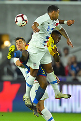 March 21, 2019 - Orlando, Florida, USA - US midfielder Weston McKennie (8), defender Aaron Long (23) and Ecuador midfielder Renato Ibarra (5) go airborne for a ball an international friendly between the US and Ecuador at Orlando City Stadium on March 21, 2019 in Orlando, Florida. .The US won the game 1-0...©2019 Scott A. Miller. (Credit Image: © Scott A. Miller/ZUMA Wire)