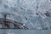 Kayakers getting up close to the massive face of the Marjorie Glacier.