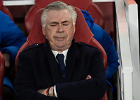 Football - 2018 / 2019 UEFA Europa League - Quarter Final, First Leg Arsenal vs. Napoli <br /> <br /> Carlo Ancelotti [ITA], manager of Napoli,  can barely watch on as his team suffer a 2-0 defeat at The Emirates.<br /> <br /> COLORSPORT/DANIEL BEARHAM