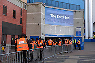 a row of extra security members are seen outside The Shed End ready to search Norwich City fans before k/o. Barclays Premier league match, Chelsea v Norwich city at Stamford Bridge in London on Saturday 21st November 2015.<br /> pic by John Patrick Fletcher, Andrew Orchard sports photography.