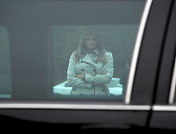 First lady Melania Trump is framed through the window of the limousine that  was used by United States President Bill Clinton as she and US President Donald J. Trump tour the US Secret Service James J. Rowley Training Center in Beltsville, Maryland on Friday, October 13, 2017.<br /> (Photo by Ron Sachs/CNP/Sipa USA)