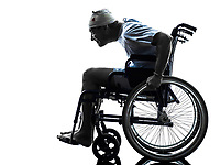 one funny careless injured man in wheelchair in silhouette studio on white background
