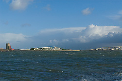 """Closed storm surge barrier.The Maeslantkering is a storm surge barrier in the Nieuwe Waterweg waterway located between the towns of Hoek van Holland and Maassluis, Netherlands, 51 57'15""""N 04 09'50""""E, which automatically closes when needed. It is part of the Delta Works & the largest moving structure on earth. It closes only when there is a storm in combination with very high tide. .This will happen once in about 5 years."""