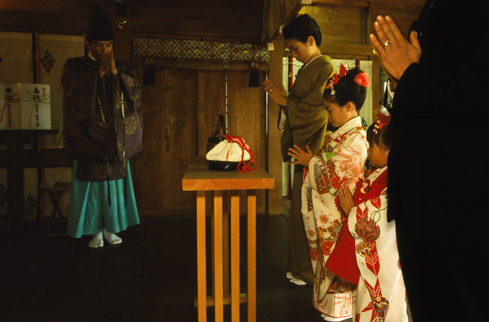Respectful bows from the family and the priest end a shichi-go-san ritual inside the Aoto Jinja shrine in Tokyo, Japan. During shichi-go-san, literally seven-five-three, parents dress their daughters aged three and seven and sons aged five in traditional costume and take them to a Shinto shrine to be blessed.