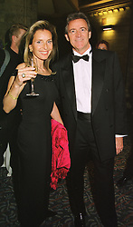 MR & MRS LINDSAY SMALLBONE members of the leading kitchen manufacturers, at a fashion show in London on 24th March 1999.MPS 41