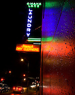 9/18/07 Omaha, NE Neon lights illuminate rain drops  on the side of Omaha Lace Laundry Cleaners at 50th and Leavenworth streets Tuesday night after a rainy day and night..Photo by Chris Machian
