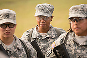 Women Drill Sergeant candidates at the US Army Drill Instructors School Fort Jackson listen during weapons training September 26, 2013 in Columbia, SC. While 14 percent of the Army is women soldiers there is a shortage of female Drill Sergeants.