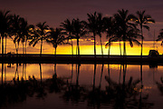 Anaehoomalu Bay sunset pictire with palm trees. Located at the Mariott Waikoloa Resort on the Kona Coast of Hawaii.
