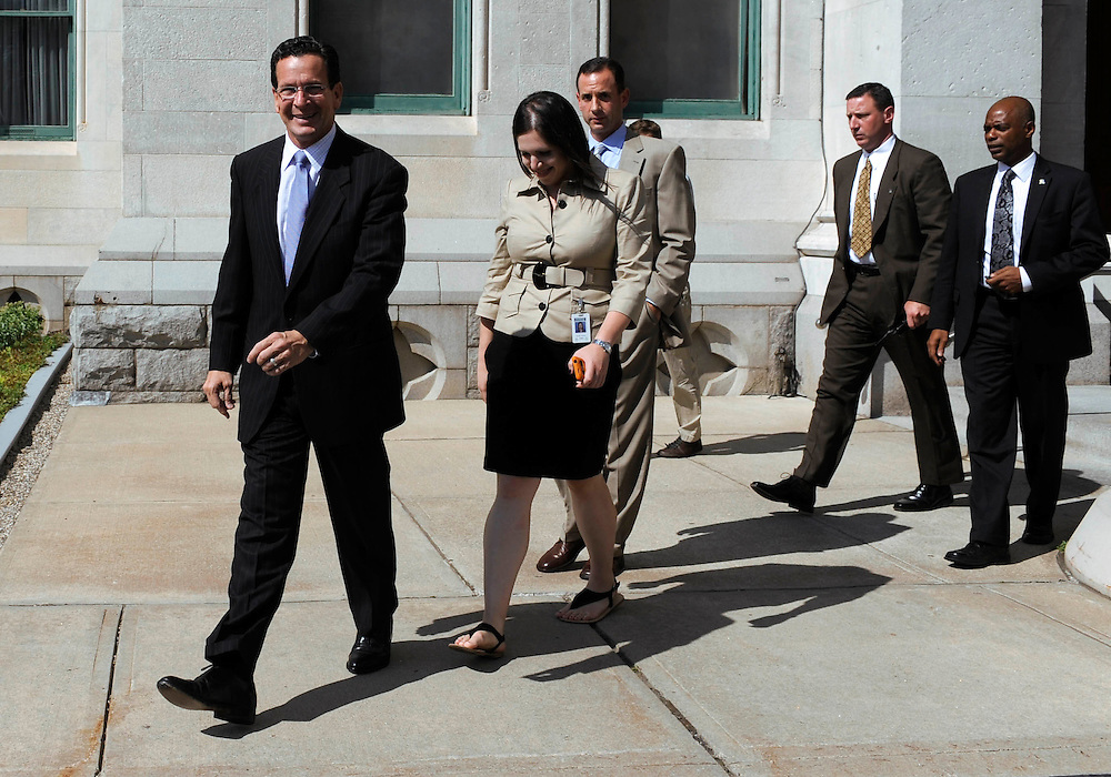 Connecticut Gov. Dannel P. Malloy, left, leaves with his staff for an event as the House and Senate are in special session at the Capitol in Hartford, Conn., Thursday, June 30, 2011.  Connecticut lawmakers returned to the state Capitol on Thursday and are expected to vote on an 11th-hour, tentative compromise reached with Gov. Dannel P. Malloy on balancing the state budget after state employees rejected a labor-savings and concessions deal. (AP Photo/Jessica Hill)