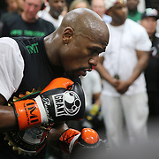 LAS VEGAS, NV - APRIL 14: WBC/WBA welterweight champion Floyd Mayweather Jr. (L) works out with Nate Jones at the Mayweather Boxing Club on April 14, 2015 in Las Vegas, Nevada. Mayweather Jr. will face WBO welterweight champion Manny Pacquiao in a unification bout on May 2, 2015 in Las Vegas.  (Photo by Alex Menendez/Getty Images) *** Local Caption *** Floyd Mayweather Jr., Nate Jones