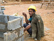 An Akha man from a nearby village working on the construction of the new village of Ban Sam Sang, Phongsaly province, Lao PDR. Four Laoseng ethnic minority villages will be relocated permanently to this new village before the end of 2015 due to the construction of the Nam Ou Cascade Hydropower project.