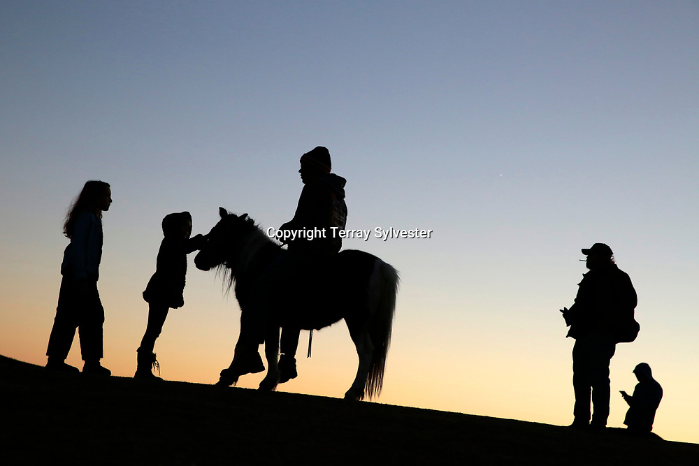 Silhouettes are seen in the opposition camp against the Dakota Access oil pipeline on November 13, 2016. Cannon Ball, North Dakota, United States.