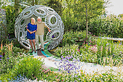 Anika Rice with David Bellamy on the Brewin Dolphin Forever Freefolk garden by Rosy Hardy - The opening day of th Chelsea Flower Show.