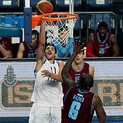 Anadolu Efes's Cenk Akyol (L) during their Turkish Basketball League match Anadolu Efes between Trabzonspor at Sinan Erdem Arena in Istanbul, Turkey, Saturday, December 10, 2011. Photo by TURKPIX