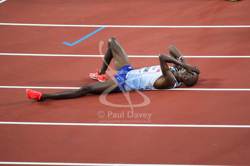London, August 12 2017 . an exhausted Mo Farah, Great Britain, lies on the track after winning silver in the men's 5000m final on day nine of the IAAF London 2017 world Championships at the London Stadium. © Paul Davey.