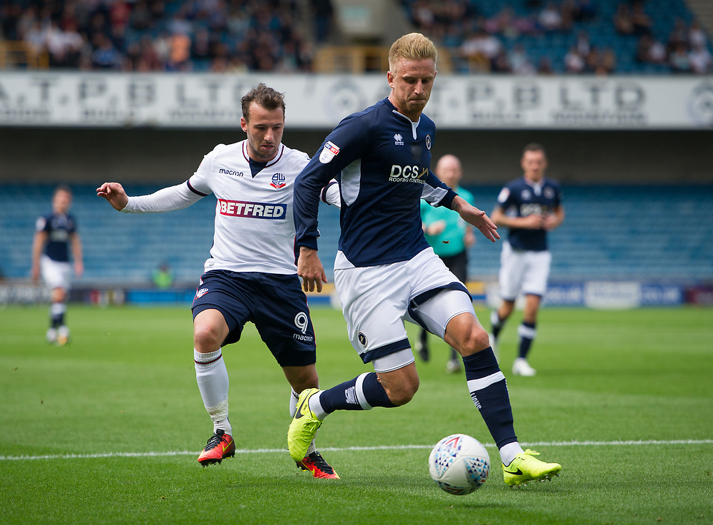 Millwall's Byron Webster holds off the challenge from Bolton Wanderers' Adam Le Fondre<br /> <br /> Photographer Ashley Western/CameraSport<br /> <br /> The EFL Sky Bet Championship - Millwall v Bolton Wanderers - Saturday August 12th 2017 - The Den - London<br /> <br /> World Copyright © 2017 CameraSport. All rights reserved. 43 Linden Ave. Countesthorpe. Leicester. England. LE8 5PG - Tel: +44 (0) 116 277 4147 - admin@camerasport.com - www.camerasport.com