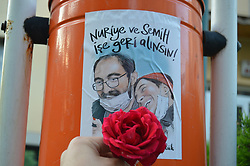 June 11, 2017 - Ankara, Turkey - A sticker with a symbolic drawing of sacked academic Nuriye Gulmen and primary school teacher Semih Ozakca, who were arrested by a court decision on the 76th day of their hunger strike, posted on a metal litter bin in Ankara, Turkey on June 11, 2017. (Credit Image: © Altan Gocher/NurPhoto via ZUMA Press)