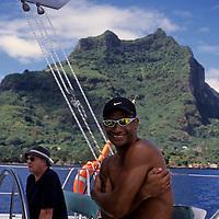 Oceania, South Pacific, French Polynesia, Tahiti, Bora Bora. Polynesian captain on catamaran cruise around Bora Bora.