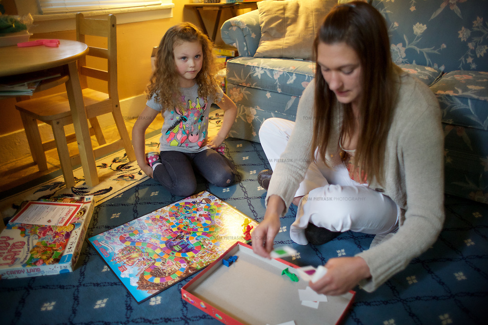 Julia at home with her daughter Annabella, age 5. Julia's apartment was provided with the assistance of the Supportive Housing program in Connecticut.<br /> <br /> Julia, 33, was raised in an abusive household and she entered foster care at the age of 9. Julia's mother was mentally ill and her father was sent to prison. As a teenager, Julia began suffering from depression. Lonely and in search of company, Julia entered a six-year, often-abusive relationship when she was only 13 years old. By the time she was 15, Julia had moved in with her older sister who became her foster parent. Julia's depression got worse, she started self-medicating with cannabis and at age 17 dropped out of school. Two years later, her mother suddenly died and Julia found life increasingly unbearable. She contemplated suicide but didn't seek help for her depression. Then Julia met Richard with whom she has shared a relationship that continues 14 years later. <br /> <br /> During what Julia describes as a traumatic period three years ago, she and Richard were arrested in a domestic dispute. The couple, by this time parents to a two year old daughter called Annabella, lost their apartment and Julia once again moved in with her sister, taking Annabella with her. The Department of Children and Families (DCF) were alerted and encouraged Julia to seek the assistance of the Supportive Housing program. In November 2014, Julia was introduced to Rose who became her case manager at the program. By January 2015, Rose had helped Julia secure an apartment subsidised by Supportive Housing. Rose offered emotional and material support, using funds to help Julia furnish her new home that was close to amenities including a park and laundromat. <br /> <br /> Rose introduced Julia to United Community Family Services who provided bus passes, signed her up with social security, disability allowance, state cash-assistance, counselling and medication-management. Never having lived with the support of a stable family 