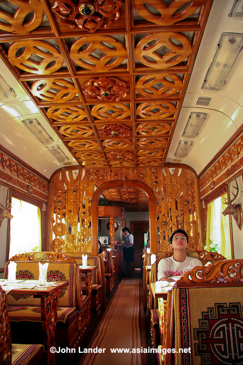 Wood Paneled Dining Car on the Trans-Mongolian Railway - The Trans-Mongolian, a branch of the Trans-Siberian Railway running from Beijing, through Mongolia onto the Russian border.  The Trans-Mongolian is a popular branch, not only because it starts or ends in Beijing but also passes through some fascinating territory along the way breaking up the endless Siberian landscape with even more exotic Mongolia.