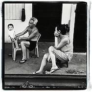 Portrait of a family living along the railway of Hanoi, Vietnam, Southeast Asia