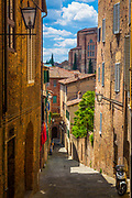 Siena is a medieval city in the region of Tuscany, located in the north of Italy some 70 km (43 mi) south of Florence. It is probably best known for a colourful horse race, Il Palio, conducted twice each year in the summer.