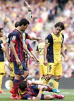 FC Barcelona's Sergio Busquets (l) and Cesc Fabregas (c) and Atletico de Madrid's Tiago Cardoso during La Liga match.May 17,2014. (ALTERPHOTOS/Acero)