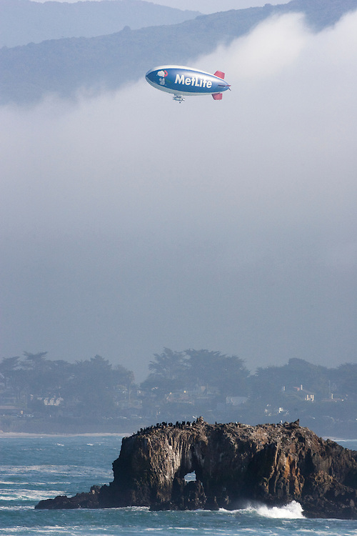 The Metlife Airship hovers over Pebble Beach Golf Links during the AT&T National Pro Am